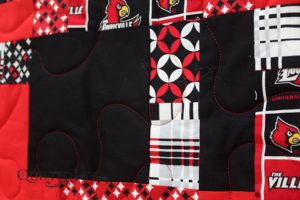 This quilt, made by Karee for a grandchild, was all about the U of L Cardinals. Of course, I had to use Glide in the color Cardinal to quilt it!