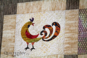 Detail of chicken from the Sparkly Chicken quilt by Beth Hunter