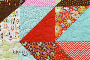 Jan's quilt incorporates both light and dark values in a fun arrangement. Come see how I quilted it on my APQS longarm and what choices we made!