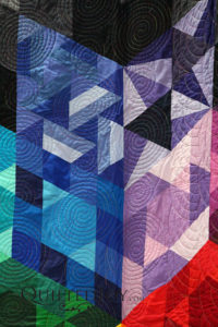 "Detail of ""Gravity"" quilt pieced and quilted by Debbie Dison, on display at Quilted Joy"