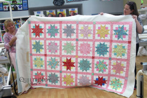 Nancy quilted her Ribbon Star quilt at Quilted Joy