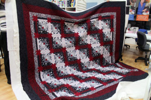 Bertie's Log Cabin with Hidden Stars quilt