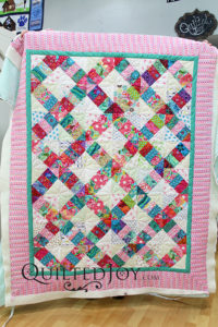 Pat made this adorable baby quilt for a family friend who just had a baby girl. And you have to see the amazing free motion quilting she added to it!