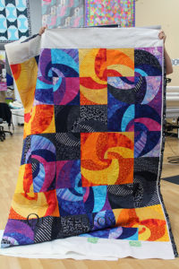 Batik Curved Piecing Quilt