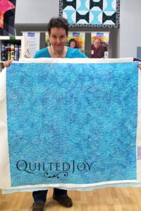 Whole cloth lap quilt