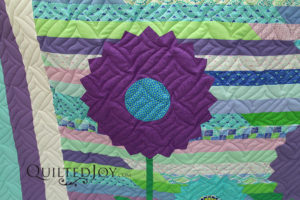Jelly Roll Quilt with Appliqued Dresden Plate Flowers