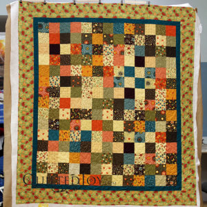 Fall Colors Quilt. Quilting by Quilted Joy