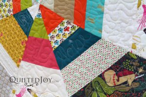 Signature quilted into quilt