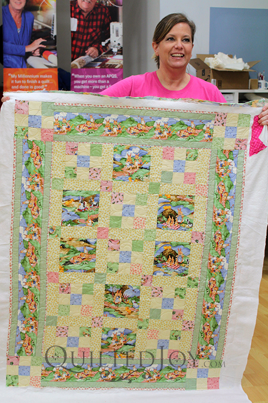Debra looks so pleased after longarm quilting for the first time!