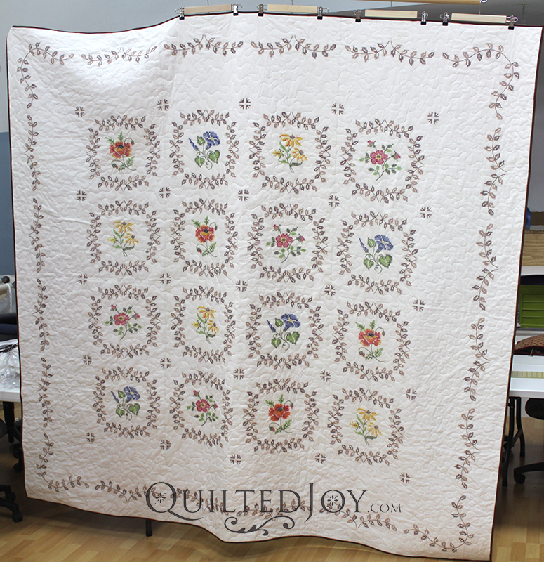 How long do your quilts wait to be quilted? Tina's floral cross stitch quilt waited 40 years to be quilted. We finally gave her quilt its day to shine!