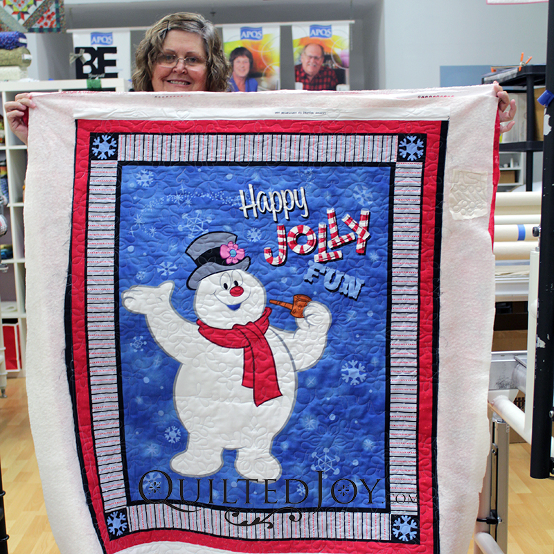 Julie quilted this Frosty the Snowman panel quilt during her rental certification class at Quilted Joy