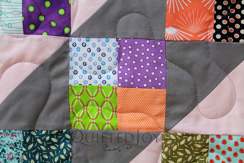 Anita took the Sunny Skies Quilt pattern and made it her own! She brought this super cute scrappy quilt to Angela Huffman for some simple meander quilting.