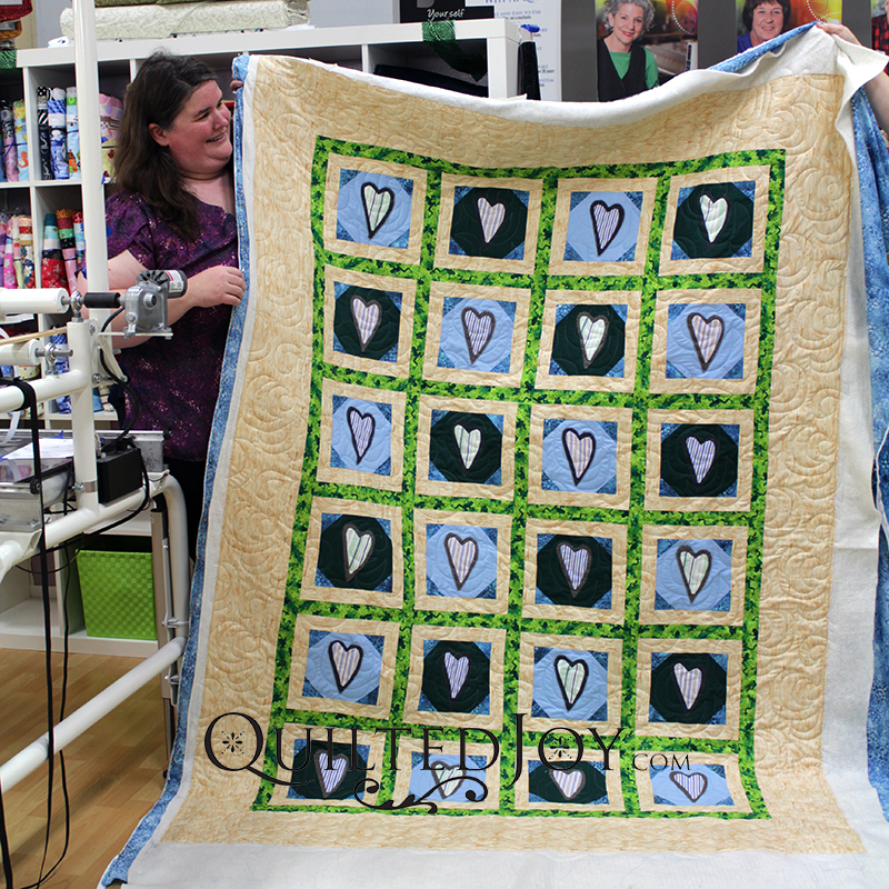 Melanie's memorial quilt made with her dad's shirts and fabrics that reminded her of him.