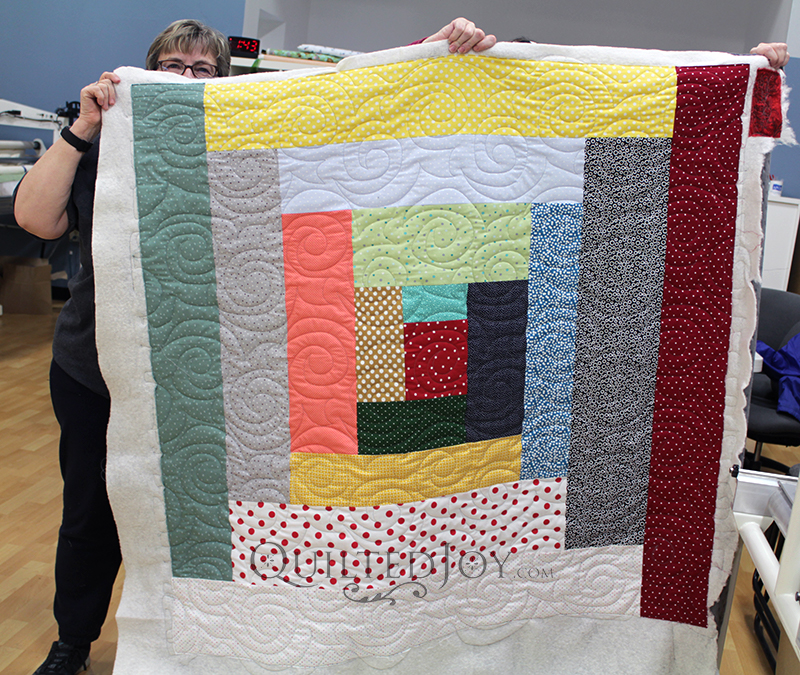 Margie supersized a log cabin block to make a playful quilt for a toddler!