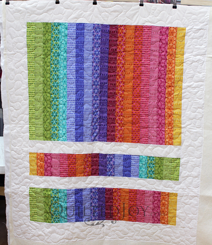 Who doesn't love a rainbow quilt? Susan brought me this adorable Stack and Flip quilt in rainbow colors for some simple meander quilting. And when you have an awesome Millie 30 it's super easy to quilt!