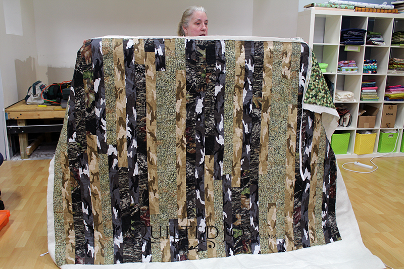 Valerie made this fun camouflage quilt for her husband. The variety of camo styles adds quite of bit texture and color. Stripes are used in the wild as a way to confuse predators. I can almost see a forest of trees in this quilt.