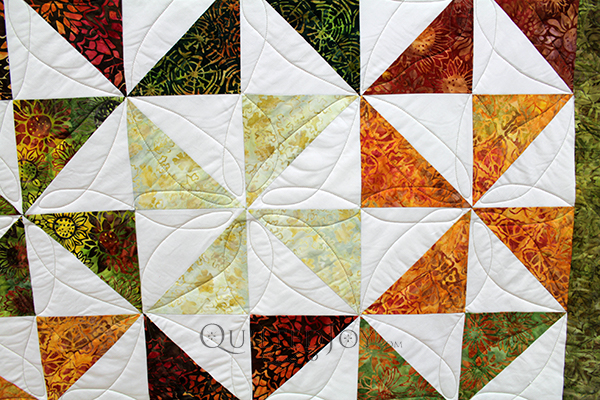 Judy made her Pinwheel quilt in beautiful reds, oranges, and greens.