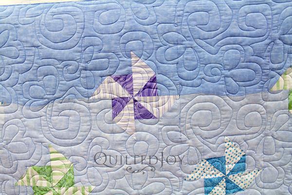 The pinwheels in Karen's quilt seem to float in the sky on her quilt!
