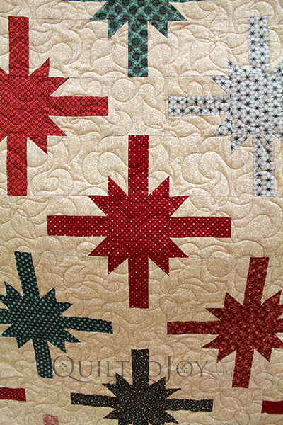 Lynn's blocks look like bows on a present, making this quilt perfect for Christmas time!