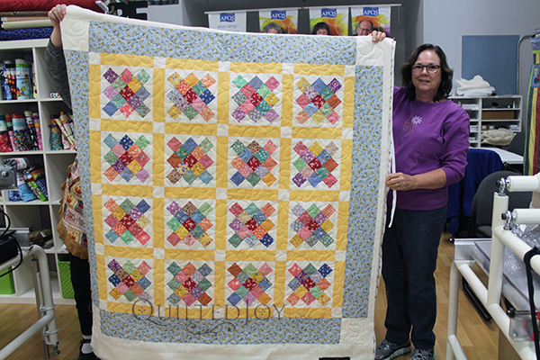 Vegetable Soup Quilt, pieced by Lynn and machine quilted at Quilted Joy.