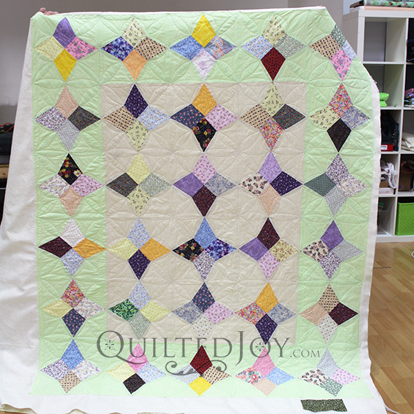 Valerie custom quilted her vintage quilt with a continuous line design.