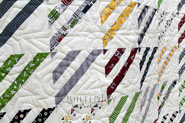Quilts for teenage boys can be so hard to design. They can't be too swirly and girly. Sandy found the sweet spot with this sports themed quilt for her grandson. I added a sporty star pantograph to finish it up for her!