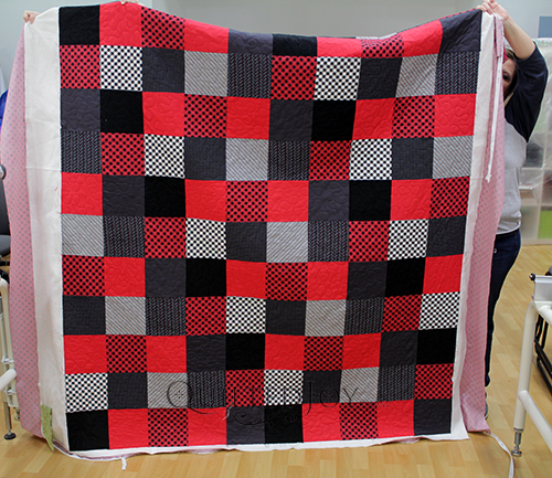 Debra's red, black, and gray squares quilt. A perfect gift for a teenage boy!
