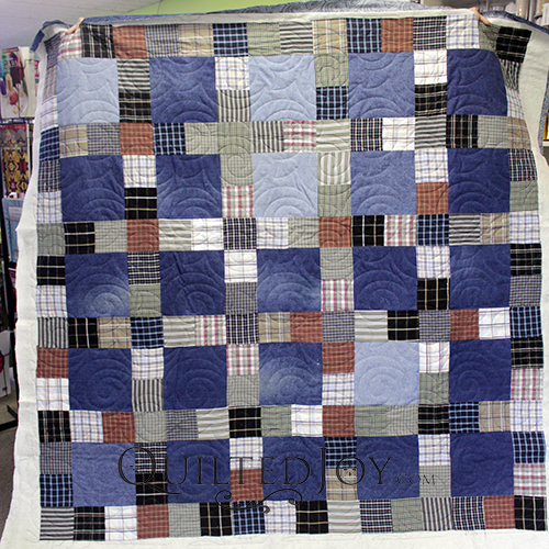 Helen made this beautiful memorial quilt. It is made up of a grandfather's blue jeans and plaid shirts. It is quilted with the Turbulance pantograph.