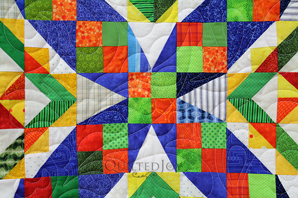 Jodi asked Angela Huffman to quilt her gorgeous Celtic Solstice quilt with a beautiful floral and feathery quilting design.