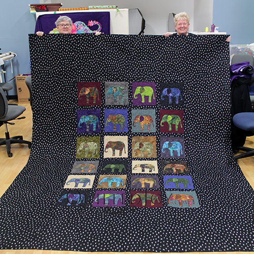 Mary and Nancy with the massive applique elephant quilt they worked on together.