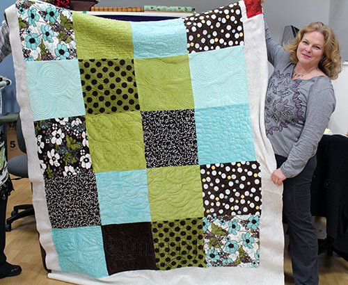 Rhonda played with lots of different quilting techniques to finish this minke quilt!