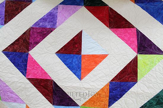 Judy's Off Centered Around the World Quilt made with half square triangles, quilted at Quilted Joy
