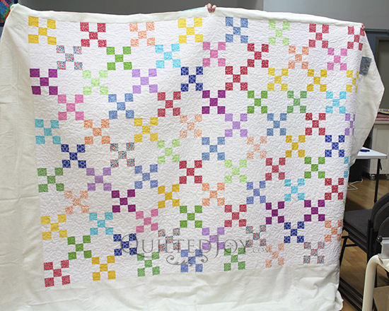 Vivian's colorful Nine Patch Quilt, quilted at Quilted Joy