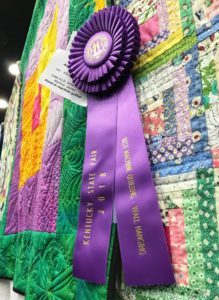 Purple Best Machine Quilting Ribbon at the Kentucky State Far for Angela Huffman's Big Ass Borders Quilt