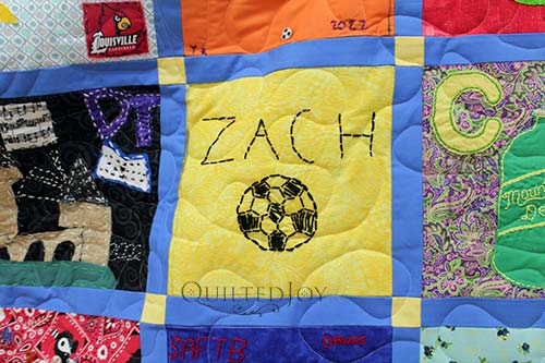 """""""Zach"""" and a soccer ball hand embroidered on a quilt block"""