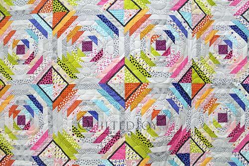 Pineapple block quilt with bright polka dot fabrics
