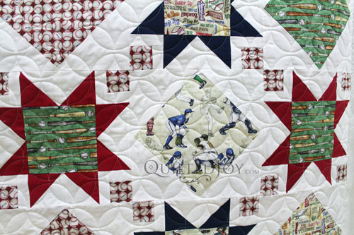 Stars and Windows quilt with baseball themed focus fabrics quilted with the orange peel design board