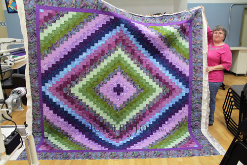 Blue, purple, and green Trip Around the World Quilt Donna was giving to a friend