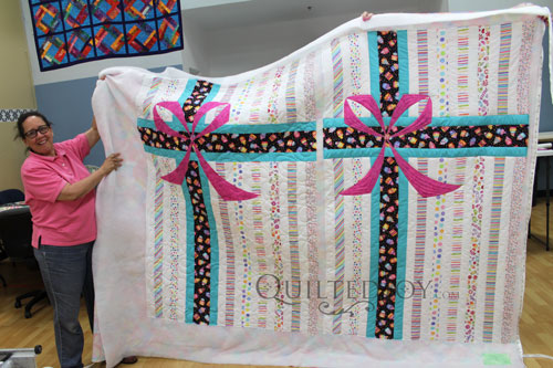 Pink Ribbon Quilts. Kathleen was Giving a Quilt to Coworkers