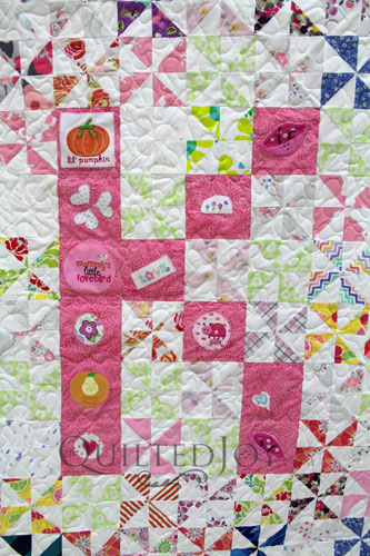 Baby Quilt with the Letter K made with baby clothes
