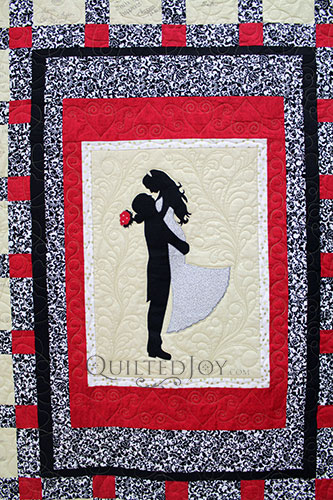 Applique of a bride and groom on a signature wedding quilt