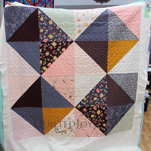 Supersized Half Square Triangles make a fast and easy quilt