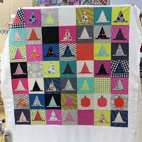 Erin's Halloween Haberdashery quilt after longarm quilting it at Quilted Joy