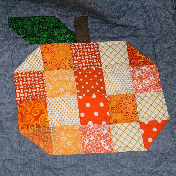 Lynn and Lisa rented longarms at Quilted Joy to machine quilt their Pumpkins Quilts