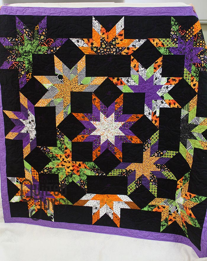 Polly's Halloween Lone Starburst Quilt after quilting it at Quilted Joy