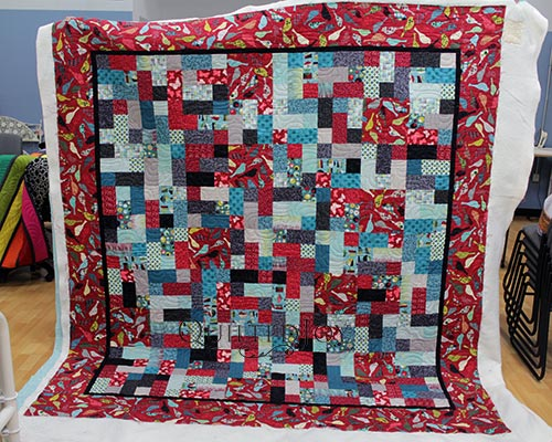 Alice's Birdy Beauty Stash Busting Quilt after a longarm machine rental at Quilted Joy