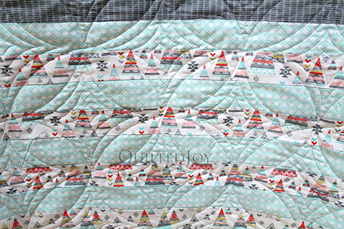 Jelly Roll Race Quilt, longarm quilting by Angela Huffman