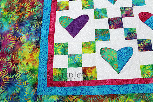 Nancy's Batik Heart Applique Quilt after longarm quilting at Quilted Joy
