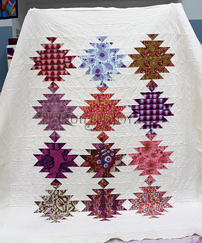 Squash Blossom Quilt after a longarm machine rental at Quilted Joy