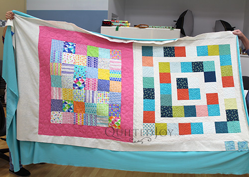 Judy's Charm Pack Quilts after longarm quilting them at Quilted Joy